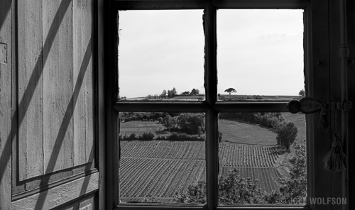 I was lucky enough to get a tour of a private castle in the country in southwestern France. I included the window itself along with the shadows and shutter because I loved how the geometry and forms go with the view. Black and White seemed an obvious choice. X-Pro2